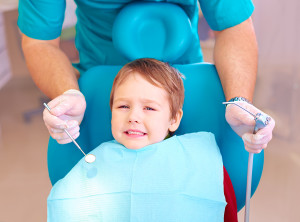 little kid patient afraid of dentist while visiting dental clinic